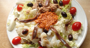 Salad made from cod, tomato, olives and onion